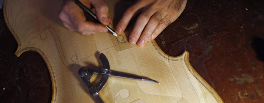 French violin maker Mathias Menanteau works as he makes a viola's belly (soundboard) at his workshop in downtown Rome December 14, 2012. Born in France, Menanteau has resided in Britain, Berlin, New York and Paris while honing his skills in making and restoring musical instruments. Besides following the traditional techniques and methods used by eighteenth-century Italian violin makers to create his own bow instruments, Menanteau also adopts the less rigid, scientific approach of dendrochronology - the science of dating events and changes by observing annual growth rings in timber - when restoring these instruments in his workshop. Picture taken December 14, 2012.  REUTERS/ Alessandro Bianchi (ITALY - Tags: SOCIETY ENTERTAINMENT)